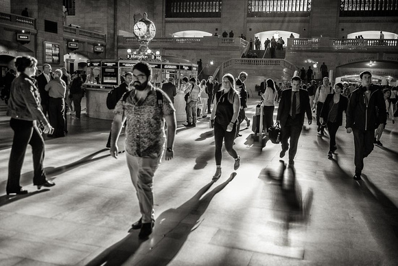 Manhattan workers exiting past the clock stand in Grand Central Station NYC